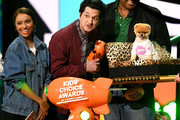 Kat Graham (L) and Ben Schwartz (C) present Favorite Instagram Pet award to Jiffpom (R) onstage at Nickelodeon's 2018 Kids' Choice Awards at The Forum on March 24, 2018 in Inglewood, California.