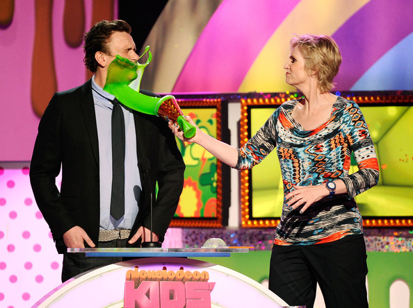 Actress Jane Lynch slimes actor Jason Segel onstage during Nickelodeon's 24th Annual Kids' Choice Awards at Galen Center on April 2, 2011 in Los Angeles, California.