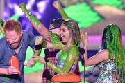 (L-R) Actors Jesse Tyler Ferguson, Rico Rodriguez, Sarah Hyland and Ariel Winter get slimed as they accept award for Favorite Family TV Show for Modern Family onstage during Nickelodeon's 28th Annual Kids' Choice Awards held at The Forum on March 28, 2015 in Inglewood, California.