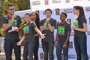 (L-R) DJ J Boogie, actors Amber Montana, Sydney Park, Jack Griffo, Curtis Harris and Kira Kosarin speak at Nickelodeon Get Dirty Earth Day at Los Angeles Zoo on March 9, 2014 in Los Angeles, California.