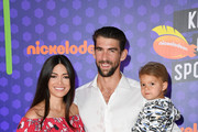 (L-R) Nicole Johnson, swimmer Michael Phelps, and Boomer Robert Phelps attend the Nickelodeon Kids' Choice Sports 2018 at Barker Hangar on July 19, 2018 in Santa Monica, California.