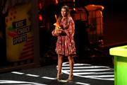 Honoree Danica Patrick accepts the Legend Award onstage during the Nickelodeon Kids' Choice Sports 2018 at Barker Hangar on July 19, 2018 in Santa Monica, California.