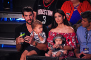 (L-R) Swimmer Michael Phelps, Boomer Robert Phelps, Nicole Johnson, and Beckett Richard Phelps attend the Nickelodeon Kids' Choice Sports 2018 at Barker Hangar on July 19, 2018 in Santa Monica, California.