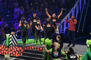(L-R) David Dobrik, Rob Gronkowski, Olivia Moultrie, P. K. Subban, and Ben Simmons react after a challenge while host Michael Strahan speaks onstage during Nickelodeon Kids' Choice Sports 2019 at Barker Hangar on July 11, 2019 in Santa Monica, California.