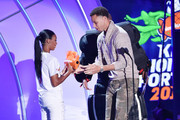 NBA player Stephen Curry (R) accepts the Clutch Player of the Year award from Little League Baseball player Mo'ne Davis onstage at the Nickelodeon Kids' Choice Sports Awards 2015 at UCLA's Pauley Pavilion on July 16, 2015 in Westwood, California.