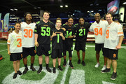 (L-R) Actor Breanna Yde, NFL players Todd Gurley, Luke Kuechly, actor Ricardo Hurtado NFL player Stefon Diggs, former NFL players Deion Sanders and DeMarcus Ware and NFL player Drew Brees attend the Superstar Slime Showdown taping at Nickelodeon at the Super Bowl Experience on February 1, 2018 in Minneapolis, Minnesota.