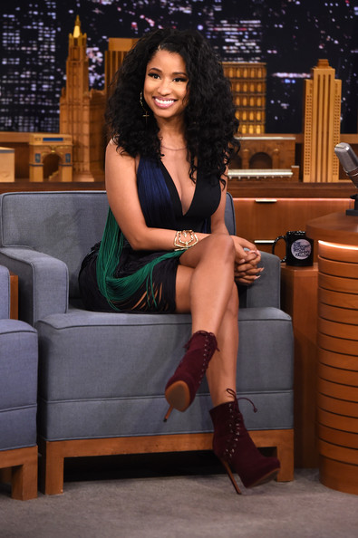 Nicki Minaj Visits 'The Tonight Show' [nicki minaj,the tonight show starring jimmy fallon,leg,thigh,human leg,clothing,beauty,lady,black hair,sitting,footwear,long hair,new york city,rockefeller center]