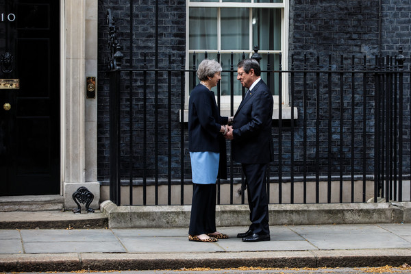 CHOGM London 2018 - Day 2 [photograph,standing,suit,snapshot,white-collar worker,urban area,businessperson,architecture,formal wear,street,theresa may,nicos anastasiades,heads,british,cypriot,state,number 10 downing street,chogm london,government,meeting]