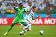 Ogenyi Onazi of Nigeria challenges Angel di Maria of Argentina during the 2014 FIFA World Cup Brazil Group F match between Nigeria and Argentina at Estadio Beira-Rio on June 25, 2014 in Porto Alegre, Brazil.
