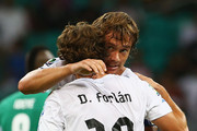 Diego Lugano of Uruguay celebrates with Diego Forlan (r) after scoring the opening goal during the FIFA Confederations Cup Brazil 2013 Group B match between Nigeria and Uruguay at Estadio Octavio Mangabeira (Arena Fonte Nova Salvador) on June 20, 2013 in Salvador, Brazil.