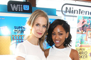 Actresses Meagan Good (L) and Laura Regan attend The Nintendo Lounge on the TV Guide Magazine yacht during Comic-Con International 2015 on July 10, 2015 in San Diego, California.