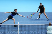 Jamie Murray of Great Britain and Bruno Soares of Brazil return the ball during their round robin match against Henri Kontinen of Finland and John Peers of Australia during Day Five of the Nitto ATP Finals at The O2 Arena on November 15, 2018 in London, England.