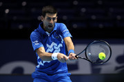 Novak Djokovic of Serbia plays a backhand during his singles semi final match against Dominic Thiem of Austria during day seven of the Nitto ATP World Tour Finals at The O2 Arena on November 21, 2020 in London, England.
