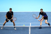 Jamie Murray of Great Britain and Brunro Soares of Brazil return the ball during doubles round robin match against Juan Sebastian Cabal of Columbia and Robert Farah of Columbia during Day Three of the Nitto ATP Finals at The O2 Arena on November 13, 2018 in London, England.