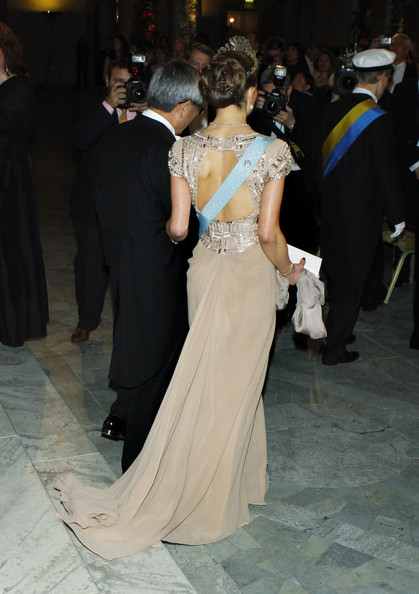 Crown Princess Victoria of Sweden and professor Ei-ichi Negishi of Japan, Nobel Laureate in Chemistry, arrive to the Nobel Banquet at the Stockholm City Hall on December 10, 2010 in Stockholm, Sweden.  The banquet features a three-course dinner, entertainment and dancing.