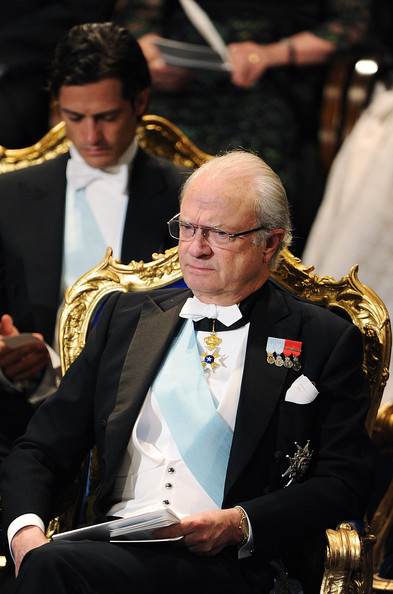 Prince Carl Philip of Sweden (L) and King Carl XVI Gustaf of Sweden (R) attend the Nobel Prize Award Ceremony at Stockholm Concert Hall on December 10, 2011 in Stockholm, Sweden.