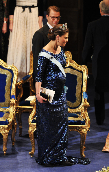 Prince Daniel of Sweden looks on as Crown Princess Victoria of Sweden leaves the Nobel Prize Award Ceremony at Stockholm Concert Hall on December 10, 2011 in Stockholm, Sweden. The Crown Princess is expecting the couple's first child.
