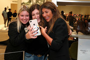 Nina Garcia (R) poses with fans during Nordstrom and ELLE Perfect Pairs Cocktail Party at Nordstrom NYC on November 07, 2019 in New York City.