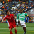 Didier Drogba Photos - Ji Yun-Nam of North Korea and Didier Drogba of the Ivory Coast battle for the ball during the 2010 FIFA World Cup South Africa Group G match between North Korea and Ivory Coast at the Mbombela Stadium on June 25, 2010 in Nelspruit, South Africa. - North Korea v Ivory Coast: Group G - 2010 FIFA World Cup