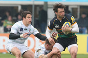 Ben Foden of Northampton is held by Alex Lewington and Fergus Mulchrone (L) during the Aviva Premiership match between Northampton Saints and London Irish at Franklin's Gardens on April 20, 2014 in Northampton, England.