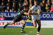 Josh Bassett of Wasps is tackled by Ben Foden during the Aviva Premiership match between Northampton Saints and Wasps at Franklin's Gardens on October 28, 2017 in Northampton, England.