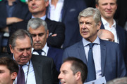 Arsenal manager Arsene Wenger (R) Gerard Houllier (L) are seen in the stand prior to the UEFA EURO 2016 Group C match between Northern Ireland and Germany at Parc des Princes on June 21, 2016 in Paris, France.
