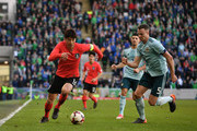Jonny Evans of Northern Ireland and Sungyueng Ki of South Korea during the international friendly match between Northern Ireland and South Korea at Windsor Park on March 24, 2018 in Belfast, Northern Ireland.