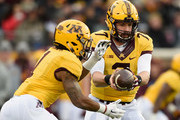 Mitch Leidner #7 of the Minnesota Golden Gophers hands off the ball to teammate Rodney Smith #1 during the first quarter of the game against the Northwestern Wildcats on November 19, 2016 at TCF Bank Stadium in Minneapolis, Minnesota.