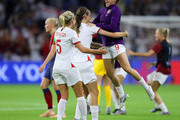 Steph Houghton, Jill Scott, and Jodie Taylor of England celebrate following their sides victory in the 2019 FIFA Women's World Cup France Quarter Final match between Norway and England at Stade Oceane on June 27, 2019 in Le Havre, France.