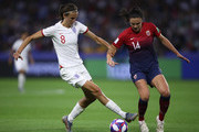 Jill Scott of England is challenged by Ingrid Syrstad Engen of Norway during the 2019 FIFA Women's World Cup France Quarter Final match between Norway and England at Stade Oceane on June 27, 2019 in Le Havre, France.