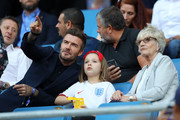 David Beckham is seen in the stands with his daughter, Harper, and mother, Sandra Georgina West prior to the 2019 FIFA Women's World Cup France Quarter Final match between Norway and England at Stade Oceane on June 27, 2019 in Le Havre, France.