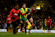 Patrice Evra and Nemanja Vidic Manchester United battle with Wes Hoolahan of Norwich City during the Barclays Premier League match between Norwich City and  Manchester United at Carrow Road on December 28, 2013 in Norwich, England.