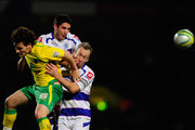 Chris Martin of Norwich City battes with Jamie Mackie and Shaun Derry of Queens Park Rangers during the npower Championship match between Norwich City and Queens Park Rangers at Carrow Road on January 1, 2011 in Norwich, England.