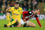 Grant Hanley of Norwich City tangels with James Wilson of Sheffield United during the Sky Bet Championship match between Norwich City and Sheffield United at Carrow Road on January 20, 2018 in Norwich, England.