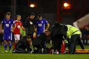 Nicklas Bendtner of Forest is stretchered off during the Sky Bet Championship match between Nottingham Forest and Birmingham City at the City Ground on October 14, 2016 in Nottingham, England.