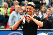 Sabine Lisicki of Germany celebrates after defeating Laura Arruabarrena of Spain during day four of the Nuernberger Versicherungscup 2016 on May 17, 2016 in Nuremberg, Germany.