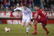 Gareth Bale of Real Madrid steals the ball from Gregorio Sierra of Numancia during the Copa del Rey match between Numancia and Real Madrid at Nuevo Estadio Los Pajarito on January 4, 2018 in Soria, Spain.