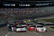 Alex Bowman, driver of the #99 Microsoft Windows Toyota, and Brad Keselowski, driver of the #22 Discount Tire Ford, lead the field at the start of the NASCAR Nationwide Series O'Reilly Auto Parts 300 at Texas Motor Speedway on November 2, 2013 in Fort Worth, Texas.
