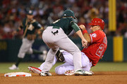 Jed Lowrie #8 of the Oakland Athletics tags Raul Ibanez #28 of the Los Angeles Angels of Anaheim out at second base on a steal attempt in the fourth inning during the MLB game at Angel Stadium of Anaheim on June 9, 2014 in Anaheim, California.