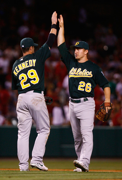 Adam Kennedy #29 and Cliff Pennington #26 of the Oakland Athletics congratulate one another following their victory over the Los Angeles Angels of Anaheim at Angel Stadium on August 29, 2009 in Anaheim, California. The Athletics defeated the Angels 4-3.