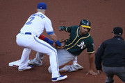 Marcus Semien #10 of the Oakland Athletics is tagged out by Troy Tulowitzki #2 of the Toronto Blue Jays in the first inning during MLB game action at Rogers Centre on July 25, 2017 in Toronto, Canada.