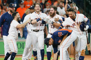 Tyler White #13 of the Houston Astros celebrates his walk-off home run against the Oakland Athletics in the ninth inning with Jose Altuve #27,Josh Reddick #22,Charlie Morton #50 and Yuli Gurriel #10 at Minute Maid Park on August 29, 2018 in Houston, Texas.