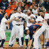 Charlie Morton Photos - Tyler White #13 of the Houston Astros celebrates his walk-off home run against the Oakland Athletics in the ninth inning with Jose Altuve #27,Josh Reddick #22,Charlie Morton #50 and Yuli Gurriel #10 at Minute Maid Park on August 29, 2018 in Houston, Texas. - Oakland Athletics vs. Houston Astros