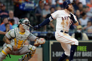 Derek Fisher #21 of the Houston Astros hits a two-run home run in the fourth inning as Bruce Maxwell #13 of the Oakland Athletics looks on at Minute Maid Park on April 28, 2018 in Houston, Texas.