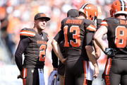 Johnny Manziel #2 looks on while Josh McCown #13 of the Cleveland Browns huddles with teammates during the second quarter against the Oakland Raiders at FirstEnergy Stadium on September 27, 2015 in Cleveland, Ohio.