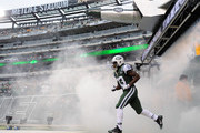 Chris Ivory #33 of the New York Jets enters the field before the game against the Oakland Raiders MetLife Stadium on December 8, 2013 in East Rutherford, New Jersey. The Jets defeat the Raiders 37-27.