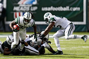 Chris Ivory #33 of the New York Jets rushes the ball against the Oakland Raiders during the fourth quarter at MetLife Stadium on September 7, 2014 in East Rutherford, New Jersey.