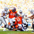 Case Keenum Photos - Quarterback Case Keenum #4 of the Denver Broncos dives into the end zone with a fourth quarter quarterback keeper touchdown against the Oakland Raiders at Broncos Stadium at Mile High on September 16, 2018 in Denver, Colorado. - Oakland Raiders vs. Denver Broncos