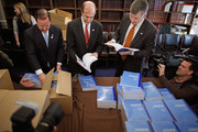 House Budget Committee members (L-R) Rep. Bill Flores (R-TX), Rep. Scott Garrett (R-NJ) and Rep. Rob Woodall (R-GA) unload boxes of President Barack Obama's proposed FY2012 federal budget in the Cannon House Office Building February 14, 2011 in Washington, DC. The budget proposal seeks to trim $1.1 trillion over 10 years mostly by freezing domestic discretionary spending. Republicans in the House say the budget doesn't go far enough in cutting federal spending.