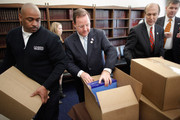 House Budget Committee members  Rep. Bill Flores (R-TX) (C), Rep. Scott Garrett (R-NJ) (2nd R) and Rep. Rob Woodall (R-GA) (R) help Office of Managment and Budget employees unload boxes of President Barack Obama's proposed FY2012 federal budget in the Cannon House Office Building February 14, 2011 in Washington, DC. The budget proposal seeks to trim $1.1 trillion over 10 years mostly by freezing domestic discretionary spending. Republicans in the House say the budget doesn't go far enough in cutting federal spending.